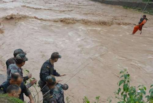 Soldiers rescue a woman trapped in flood hit Jammu and Kashmir
