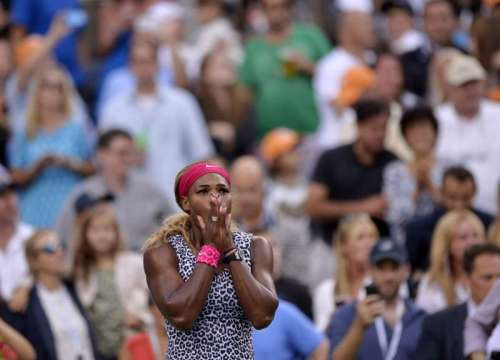 Serena Williams of the United States celebrates after the women's singles final match against Caroline Wozniacki of Denmark at the 2014 U.S. Open in New York