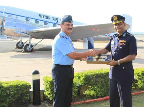 The Air Officer Commanding in Chief Western Air Command, Air Marshal S.S. Soman hands over the symbolic key to the Chief of Bangladesh Air Force, Air Marshal Muhammad Enamul Bari, during the Dakota aircraft presentation ceremony, at Palam, in New Delhi