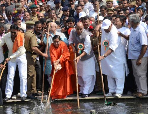 Union Home Minister Rajnath Singh, Union Minister for Water Resources, River Development and Ganga Rejuvenation Uma Bharati and others clean the Gomti river during a clean Gomti campaign in Lucknow