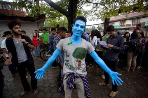 A Nepalese youth painted in blue participates in the people's climate march in Kathmandu, Nepal
