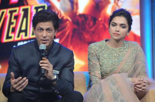 Actors Shahrukh Khan and Deepika Padukone during the music launch of film Happy New Year in Mumbai on Sept 15, 2014.