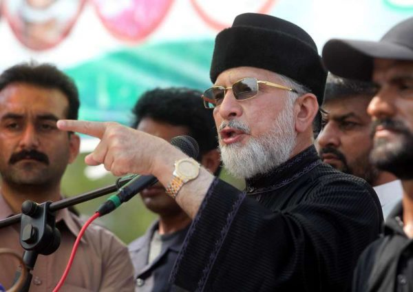 """Pakistani religious leader Tahir-ul-Qadri speaks during an anti-government protest site in front of Parliament in Islamabad, capital of Pakistan on Sept. 19, 2014. Pakistani Prime Minister Nawaz Sharif on Friday accused two protesting parties of """"inciting people to opt for munity"""" but made it clear that few thousands people would never succeed in their """"sinister designs"""" to derail the system."""
