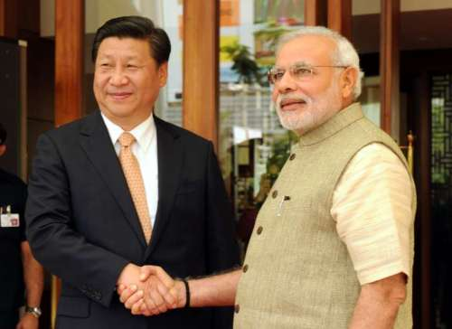 The Prime Minister, Shri Narendra Modi welcoming the Chinese President, Mr. Xi Jinping, at Hyatt Hotel, Ahmedabad