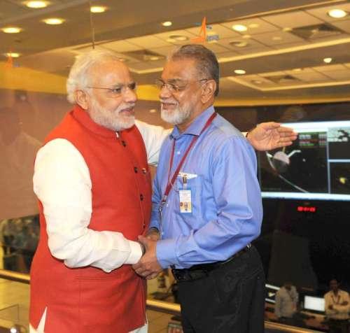 The Prime Minister, Shri Narendra Modi congratulating the ISRO Chairman, Dr. K Radhakrishnan after successful Insertion of Mars Orbiter (Mangalyan) into the Mars orbit, at ISRO Headquarters, in Bengaluru. FILE PHOTO