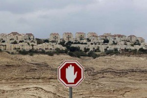 A stop sign is seen outside the West Bank Jewish settlement