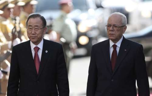 United Nations Secretary General Ban Ki-Moon and Palestinian presidency's secretary general Tayeb Abdul-Rahim review an honor guard in the West Bank city of Ramallah