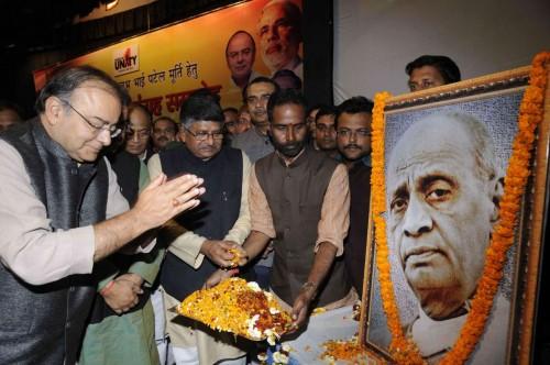 Senior BJP leaders Arun Jaitley and Ravi Shankar Prasad paying tributes to ``Iron man of India`` Sardar Vallabh Bhai Patel during the BJP`s state function at S K Memorial Hall in Patna