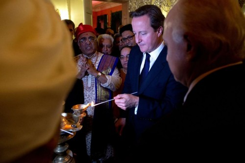 Prime Minister David Cameron lights the Lamp to inaugurate the Diwali celebrations at No 10