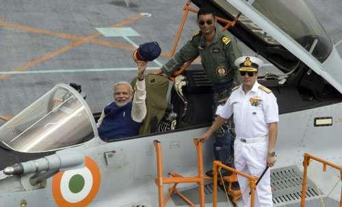 Prime Minister Narendra Modi in a fighter jet MIG 29K during the handing over of INS Vikramaditya to India Navy in Panaji. FILE PHOTO