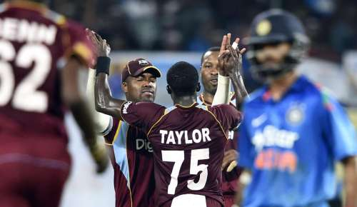 West Indians celebrate after fall of wicket during the first ODI match between India and West Indies at Jawaharlal Nehru Stadium in Kochi