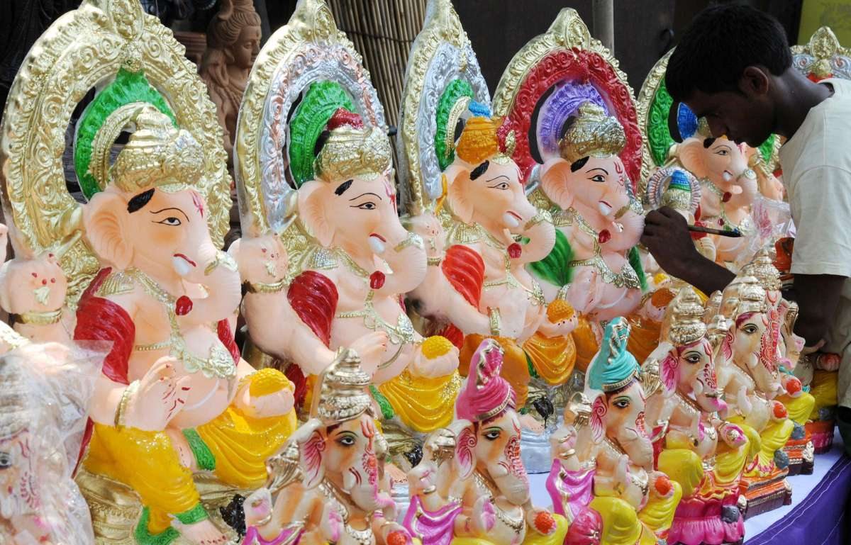 An artist gives final touches to Ganesha idols ahead of Ganesh Chaturthi in Amritsar on Aug 6, 2014. (Photo: IANS)