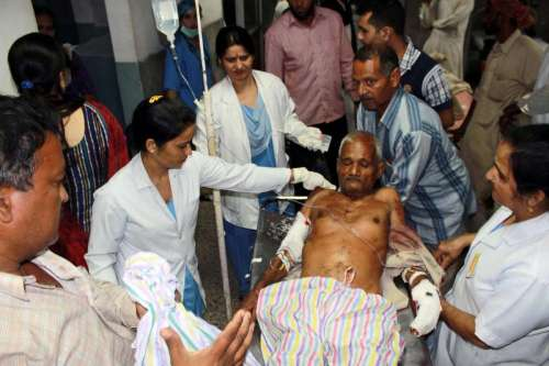 An elderly person, injured during cross border firing at RS Pora sector of Jammu, being wheeled into a Jammu hospital for treatment, on Oct.8, 2014. Twenty people were injured in overnight Pakistani firing at the border in Jammu and Kashmir.