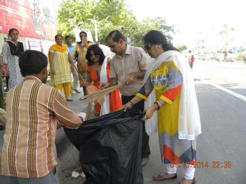 Delhi Tourism department officials participate in `Swacch Bharat Mission` - a nationwide campaign that aims to clean up India in five years - in New Delhi
