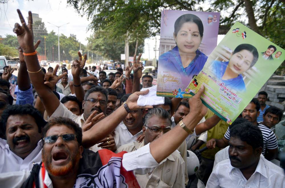 Supporters of AIADMK supremo and former Tamil Nadu Chief Minister J Jayalalithaa gather at Karnataka High Court during a hearing of the Rs.66-crore disproportionate assets case against their leader in Bangalore