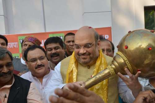New Delhi: BJP chief Amit Shah during a press conference in New Delhi, on Oct.19, 2014. The party won Haryana Assembly Polls and has secured 123 seats in Maharashtra.