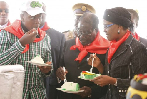 Zimbabwe's President Robert Mugabe (C) eats a piece of cake with his wife Grace Mugabe and their son during celebrations to mark his 90th birthday at Marondera, 75 km from Harare, Zimbabwe