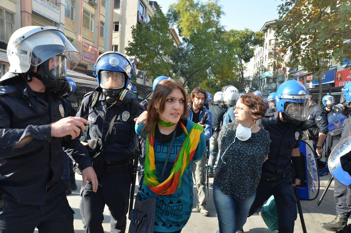 Policemen arrest protestors in Ankara, capital of Turkey, on Oct. 7, 2014. Turkish authorities imposed a curfew in five provinces after at least 12 people were killed during anti-Islamic State (IS) protests, local news agency Dogan reported Wednesday. The curfew was declared in the southeastern provinces of Mardin, Van, Siirt, Batman and Diyarbakir in an effort to disperse demonstrations against the advance of IS militants into Kurdish populated Kobane town in northern Syria.