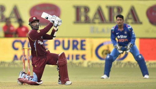 West Indian cricketer Marlon Samuels in action during the first ODI match between India and West Indies at Jawaharlal Nehru Stadium in Kochi on Oct.8, 2014.