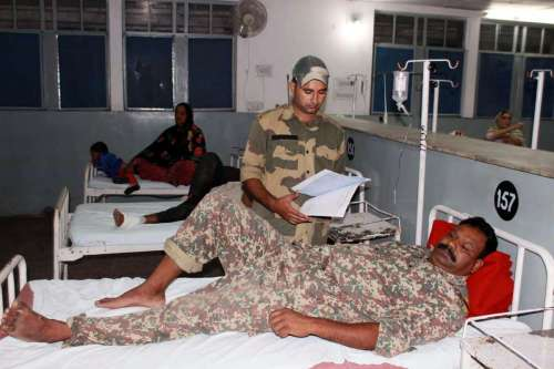 An injured BSF jawan - who got injured in cross border firing at Indo -Pak border in RS Pora sector of Jammu - being treated at a Jammu hospital.Twenty people were injured in overnight Pakistani firing at the border in Jammu and Kashmir.
