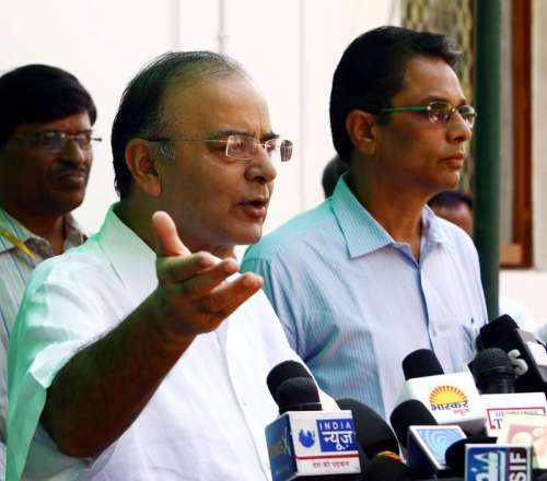 Union Minister for Finance, Corporate Affairs and Defence Arun Jaitley briefs press regarding tensions prevailing at Indo-Pak border in Jammu and Kashmir in New Delhi, on Oct.9, 2014. Also seen DG (Media & Communication), MoD, Shri Sitanshu Kar. Seven civilians have been killed so far in Pakistani firing in civilian areas close to the border since Oct 6. A total of 60 people have been injured, including five who were injured Wednesday night. (Photo: IANS/PIB)