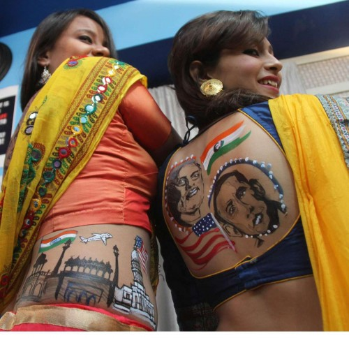 Women show a body art depicting US President Barack Obama, Prime Minister Narendra Modi, Indian flag, Red Fort and White House in Ahmedabad, on Sept. 26, 2014. (Photo: IANS)