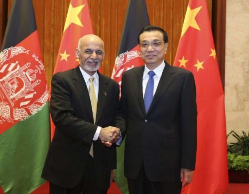 Chinese Premier Li Keqiang (R) meets with visiting Afghan President Ashraf Ghani Ahmadzai in Beijing, capital of China