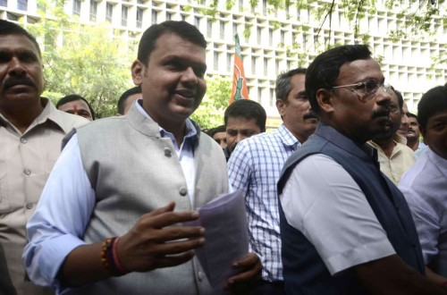 Mumbai: Maharashtra BJP chief Devendra Fadnavis, party leader Vinod Tawde and other newly-elected legislators of BJP arrive to attend a meeting to elect new BJP Legislature Party leader, in Mumbai, on Oct.28, 2014. Union Home Minister Rajnath Singh, senior party leaders Rajiv Pratap Rudy, O.P. Mathur and J.P. Nadda will oversee the election.