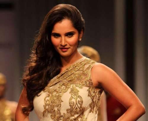 Indian tennis player Sania Mirza walks the ramp displaying an outfit by designers Shantanu and Nikhil during the Aamby Valley India Bridal Fashion Week (IBFW) 2013, in Mumbai on December 2, 2013.
