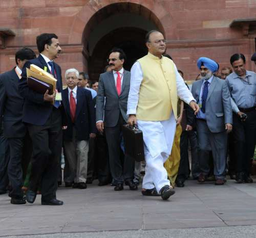 Union Minister for Finance, Corporate Affairs and Defence Arun Jaitley leaves for the Parliament from North Block to present General Budget 2014-15 in New Delhi on July 10, 2014. (Photo: IANS)
