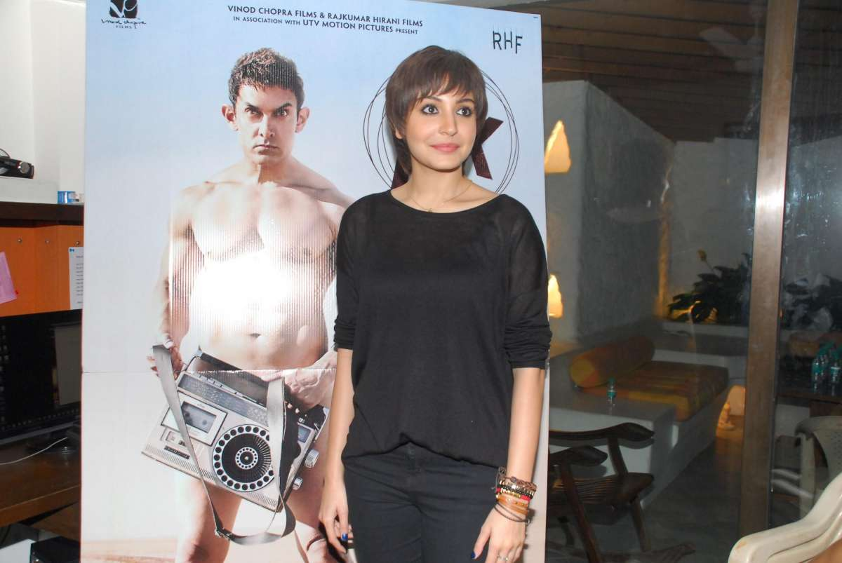 Actor Anushka Sharma speaks to the media as she reveals her look for the upcoming film PK in Mumbai on Oct. 16, 2014. (Photo: IANS)