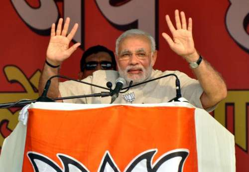 Prime Minister Narender Modi addressing during Vijay Haryana Rally in Faridabad on Oct. 6, 2014. (Photo: IANS)