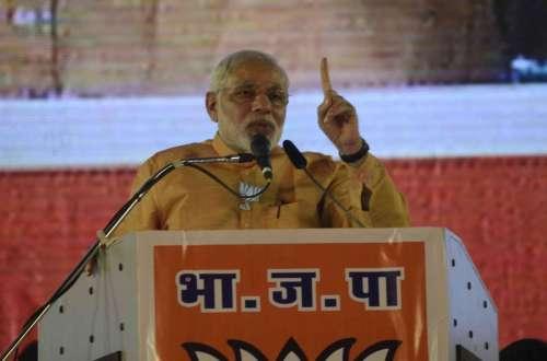 Prime Minister Narendra Modi addresses during a rally at Mahalaxmi Racecourse in Mumbai, on Oct.4, 2014. (Photo: Sandeep Mahankal/IANS)