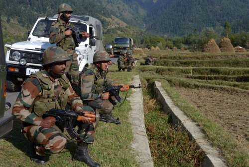 Soldiers in action during an encounter in Kupwara of Jammu and Kashmir . One alleged militant was killed in the encounter.