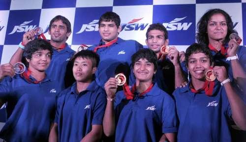Medal winners in Glasgow 2014 Commonwealth Games Vinesh Phogat, Babita Kumari, Amit Kumar, Bajrang, Sushila Devi, Sakshi Kumar, Navjot Kaur and Pawan Kumar during a felicitation function in New Delhi on Aug 6, 2014. (Photo: IANS)