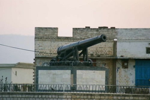 A nineteenth century cannon sits at the centre of a Pakistani village