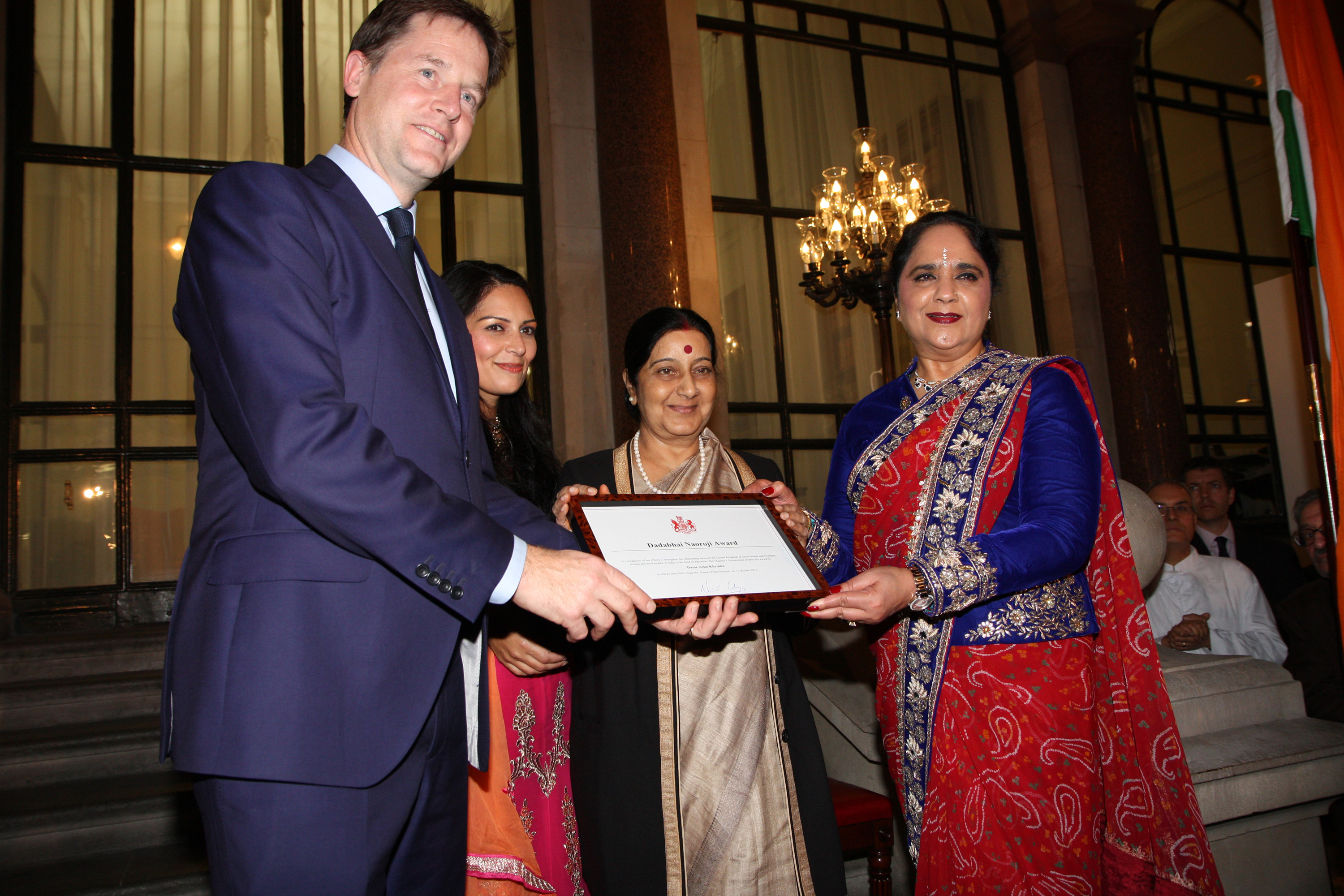 Dame Asha receives Dadabhai Naoroji Award from Deputy Prime Minister Nick Clegg as Indian Minister Sushma Swaraj and Priti Patel look on
