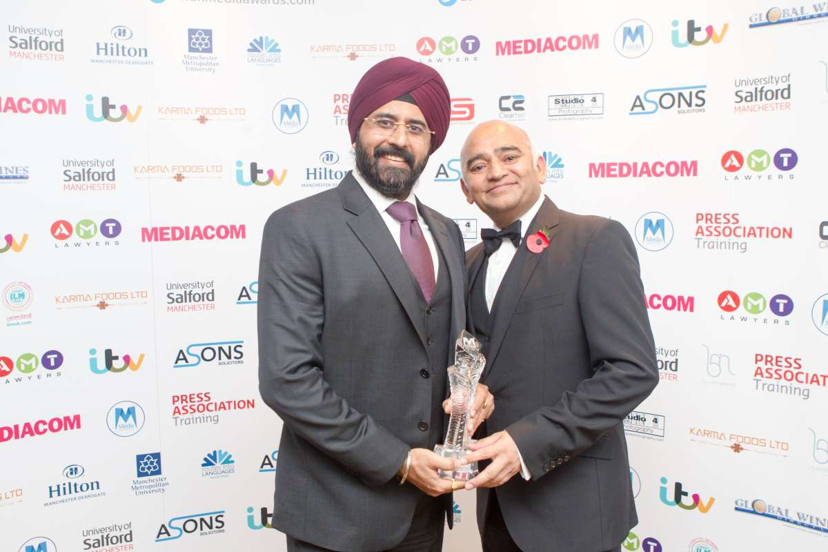 Gurjeev Singh Kapoor of Star TV accepts award from popular British actor Bhasker Patel