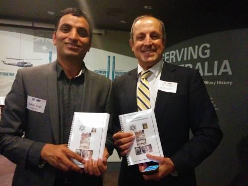 Balesh Singh Dhankar of Hindu Council of Australia presenting a book to Vic Alhadeff, CEO NSW Jewish Board of Deputies on Haifa Day celebration.