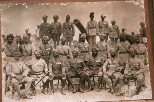 Sepoys and officers of Dulmial pose with the cannon