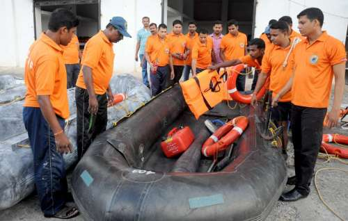 Odisha Disaster Rapid action force (ODRAF) personnel test their raft in light of Indian Meteorological Department's cyclone alert for the north coastal Andhra Pradesh