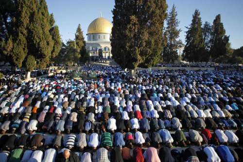 Muslims pray in front of the Dome of the Rock at the compound known to Muslims as al-Haram al-Sharif and to Jews as the Temple Mount in Jerusalem's Old city, on Oct. 4, 2014 on the first day of Eid al-Adha. Muslims around the world celebrate Eid al-Adha to mark the end of the Haj by slaughtering sheep, goats, cows and camels to commemorate Prophet Abraham's willingness to sacrifice his son Ismail on God's command.