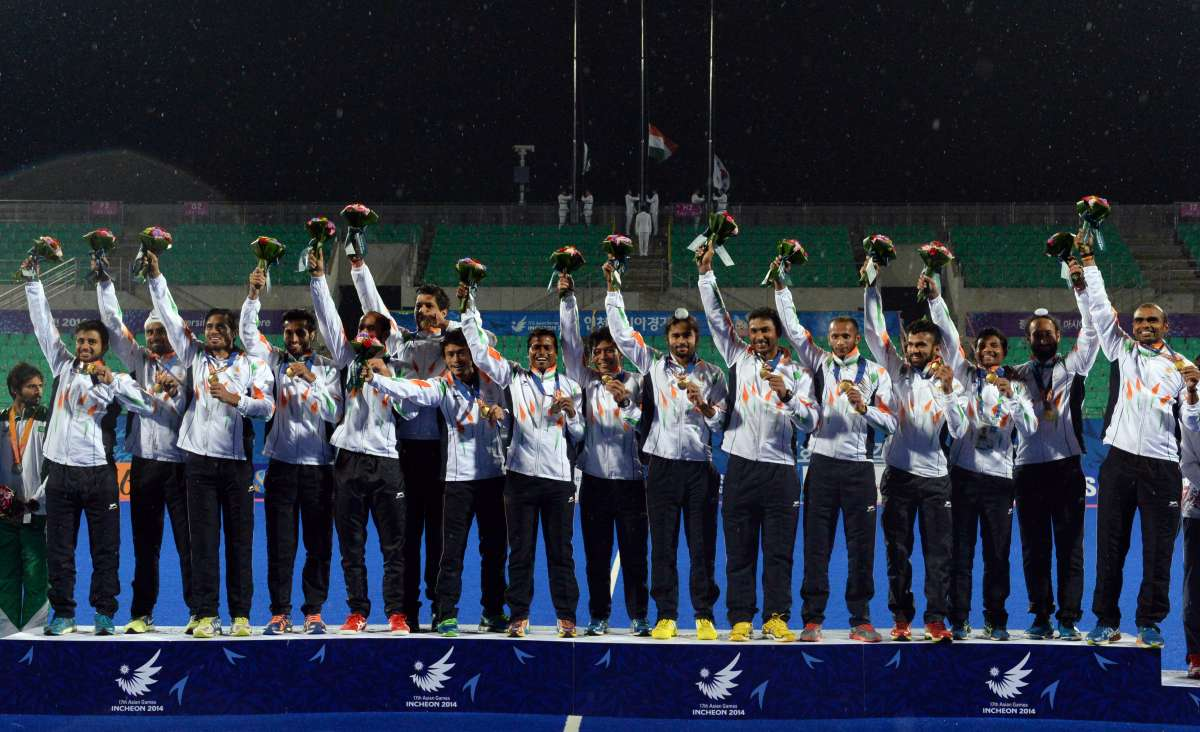 Gold medalists players of India pose on the podium during the awarding ceremony of the men's hockey contest at the 17th Asian Games in Incheon, South Korea,