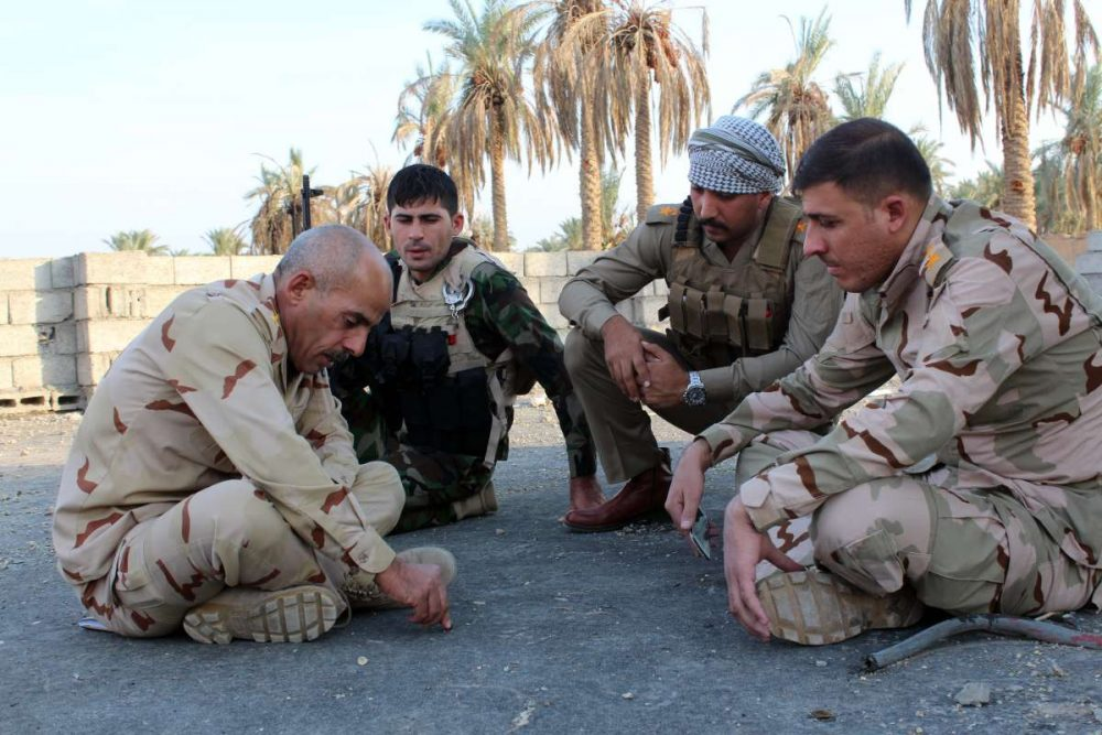 Army officers fighting the terrorists of Islamic State discuss about their plans in the Jabour area, north western town of Dhuluiya, Iraq