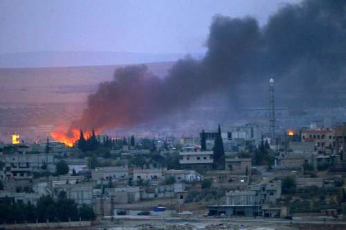 Smoke rises after an US airstrike on positions of Islamic State (IS) terror group in Kobani, Syria, on Oct. 15, 2014. The airstrikes initiated by a US-led coalition against IS continued in the southtern part of Syrian border city of Kobane