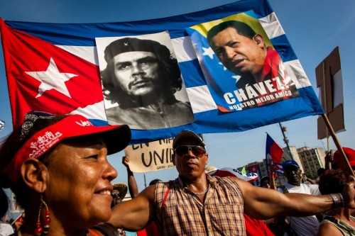 (140501) -- HAVANA, May 1, 2014 (Xinhua) -- People participate in the May Day parade organized by the Cuban Workers Union (CTC) at Revolution Square in Havana, capital of Cuba, on May 1, 2014. According to an official estimate, some 600,000 workers joined the parade. (Xinhua/Liu Bin)
