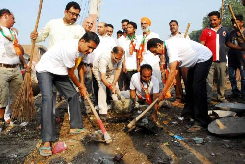 BJP workers participate in `Swachh Bharat Abhiyan` - a cleanliness drive initiated by Prime Minister Narendra Modi in Amritsa