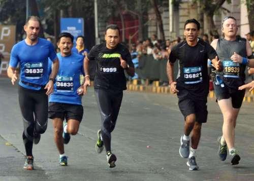 Anil Ambani chairman of Anil Dhirubhai Ambani Group (ADAG) participates in Mumbai Marathon 2014, in Mumbai on Jan.19, 2014. (Photo: Sandeep Mahankal/IANS)