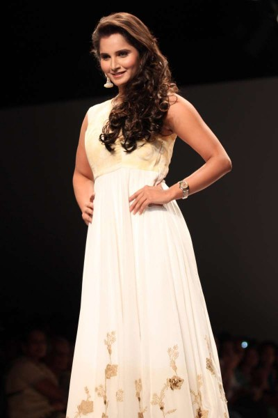 Indian tennis player Sania Mirza walks on the ramp for designer Ritu Pande show at the Wills Lifestyle India Fashion Week Spring Summer 15, in New Delhi