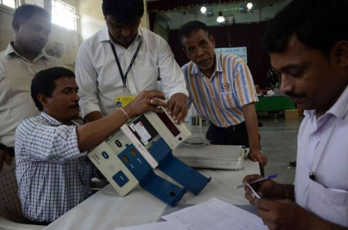 Polling personnel inspect Electronic Voting Machines ahead of Maharashtra Assembly polls in Mumbai, on Oct.8, 2014. (Photo: Sandeep Mahankal/IANS)